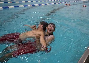 Ian Clute practices rescuing Jacob Simora during lifeguard in service training Tuesday, June 21, 2016, at the Turner Community Center pool. The pool has been closed while undergoing renovations and is expected to reopen before the start of the season.