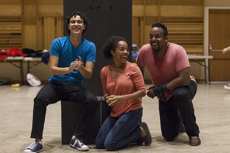 "Left to right: Chautauqua Theatre Conservatory actors Josh Grosso, Brittany Bradford, and David Samuel applaud for playwright Jayson Kell, a third grade student at Fletcher Elementary. Kell's play ""The Riot"" was performed in Lenna Hall on June 20, 2016, as part of the Young Playwrights Festival. The Young Playwrights Festival is part of a collaboration between the Chautauqua Theatre Conservatory and the Florida Studio Theatre. Photo by Carolyn Brown."