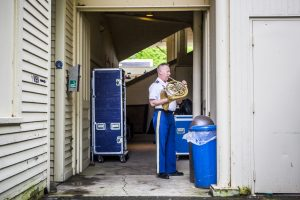 A member of The United States Army Field Band & Soldiers' Chorus practices before the Chautauqua Institution's first Sunday concert at the Amphitheater June 27, 2015.