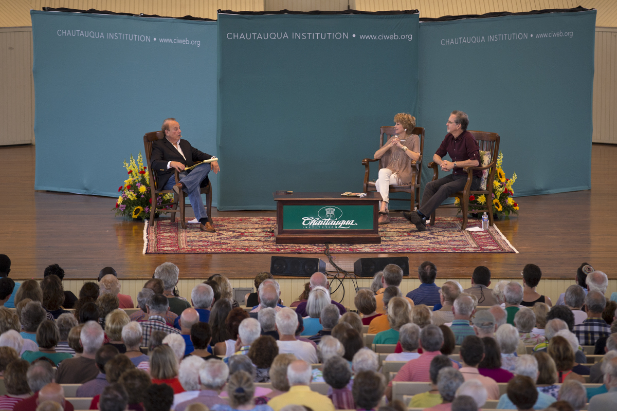 "Roger Rosenblatt, left, interviews Jane Pauley and her husband Garry Trudeau during the morning lecture Monday, June 27, 2016, at the Amphitheater. Pauley is a journalist and Trudeau is the Pulitzer Prize winning creator of ""Doonesbury."""