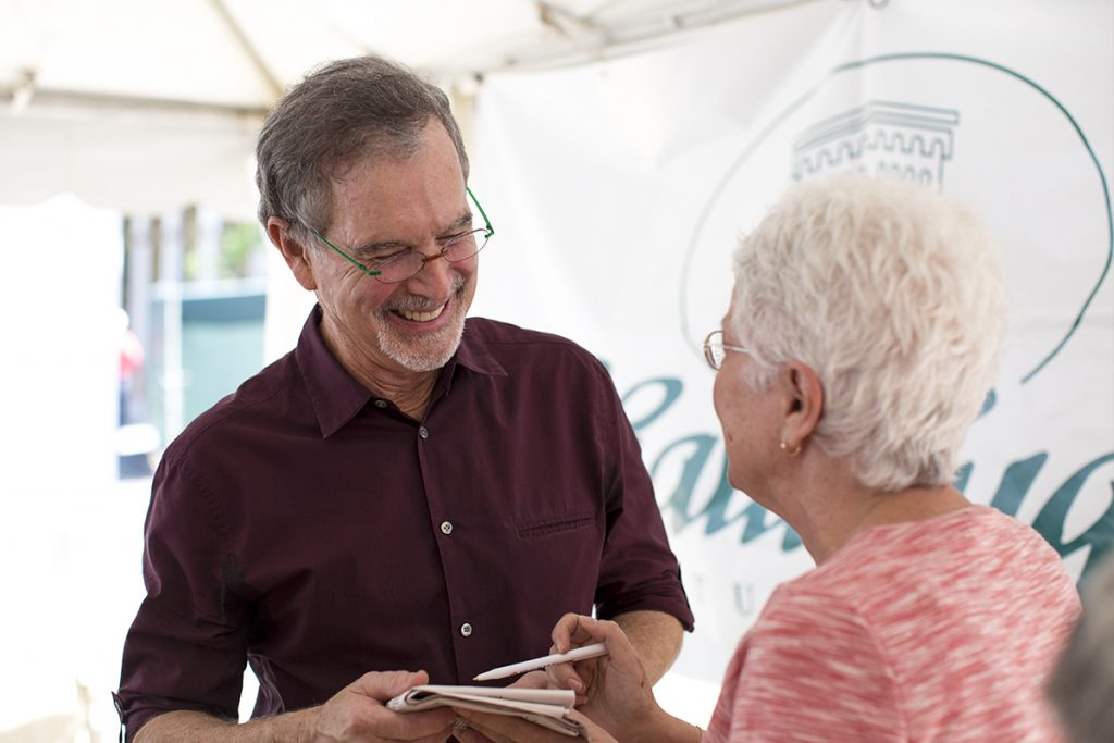 "Gary Trudeau meets Nancy Feldman after speaking in the morning lecture Monday, June 27, 2016, in the Artists Village. Trudeau is the Pulitzer Prize winning creator of ""Doonesbury."" Photos by Mike Clark."