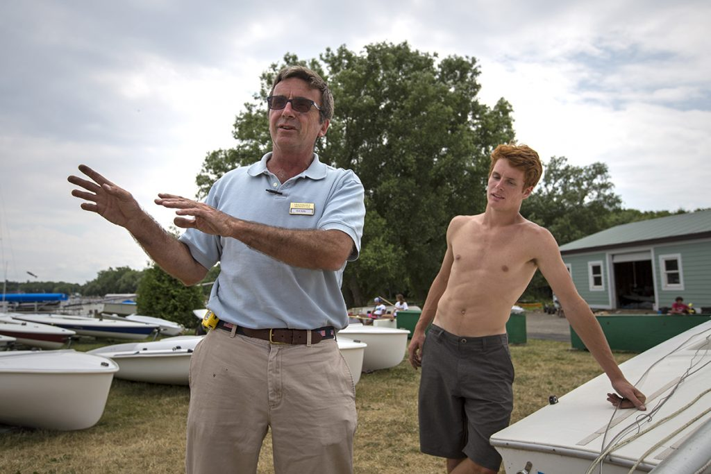 Sailing Director Kirk Kelly, left, speaks to the sailing instructors, including his son Thomas Kelly, right, Thursday, June 23, 2016, at John R. Turney Sailing Center. The instructors were cleaning and rigging the boats in preparation for the start of the season. Photo: Mike Clark.