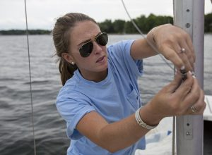 Sailing instructor Bailey Carter rigs a sailboat Thursday, June 23, 2016, at the John R. Turney Sailing Center docks. The instructors were cleaning and rigging the boats in preparation for the start of the season.