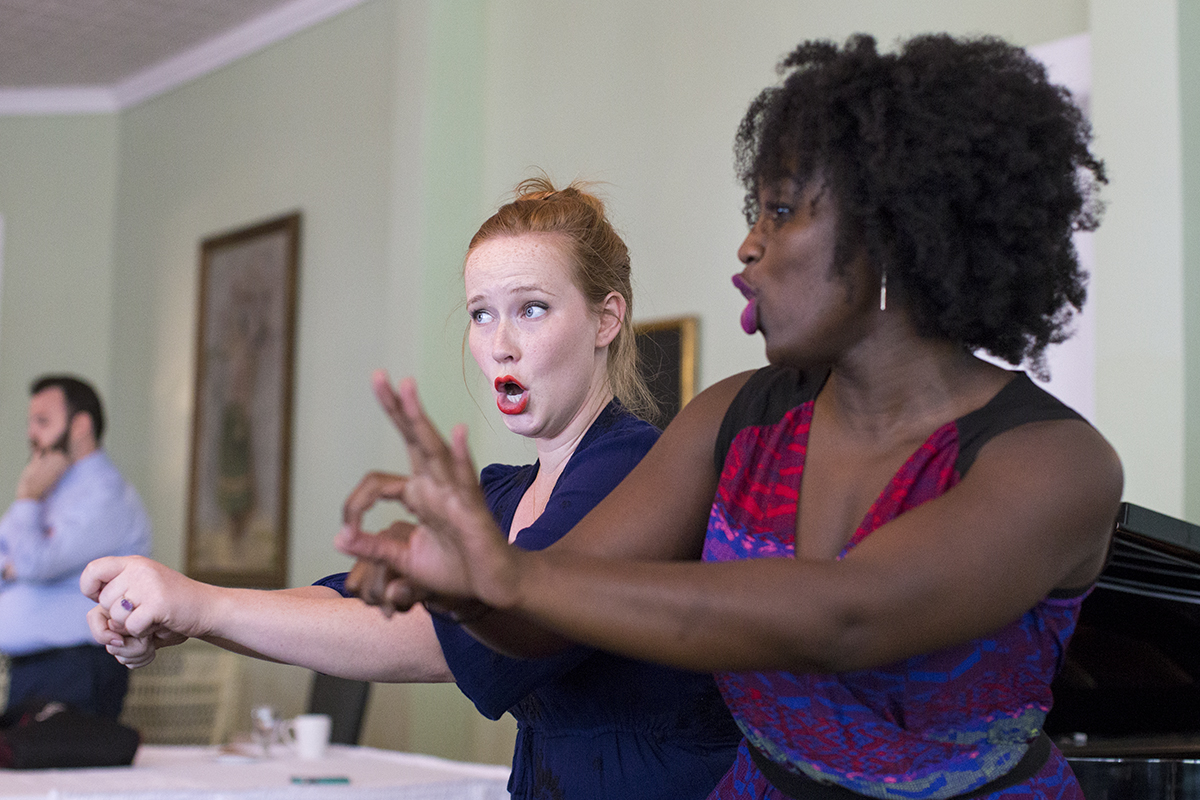 Addie Hamilton, left, and Tesia Kwarteng sing a duet during a dress rehearsal for the afternoon Recital of Song on Tuesday, June 28, 2016 in the Athenaeum Hotel's parlor. Photo by Mike Clark.