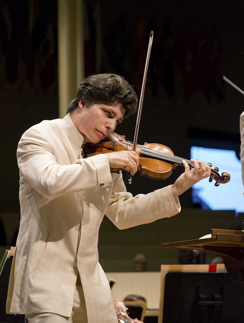 Photo | Amanda Mainguy  Guest Violinist Mr. Augustin Hadelich performs an interlude from Dutilleux's concerto for violin and orchestra July 17, 2014.