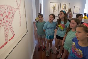 "Members of Mrs. DeAngelo's 4th grade class from Panama Elementary look at ""Making Room for the Monkey"" by Patricia Bellan-Gillen on Friday, June 17, 2016 at the Fowler-Kellogg Art Center. The gallery opened a week early to give local students a chance to visit before their semester ends."