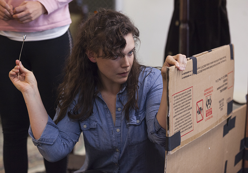 "Actress Kathryn Metzger, as the character Catherine Givings, rehearses a scene from the Chautauqua Theater Company's upcoming production of Sarah Ruhl's ""In the Next Room (or the vibrator play),"" directed by Larissa Kokernot, in Brawdy Theater Studios on June 25, 2016. In the show, Metzger plays a Victorian woman who, with her friend Sabrina Daldry (played by Allison Altman, standing), rediscovers her own sexuality when her husband, a doctor, introduces her to a mechanism that we know today as a vibrator. In this scene, Givings uses Daldry's hat pin to unlock the door to her husband's office so that the two women can use the mechanism. Photos by Carolyn Brown."