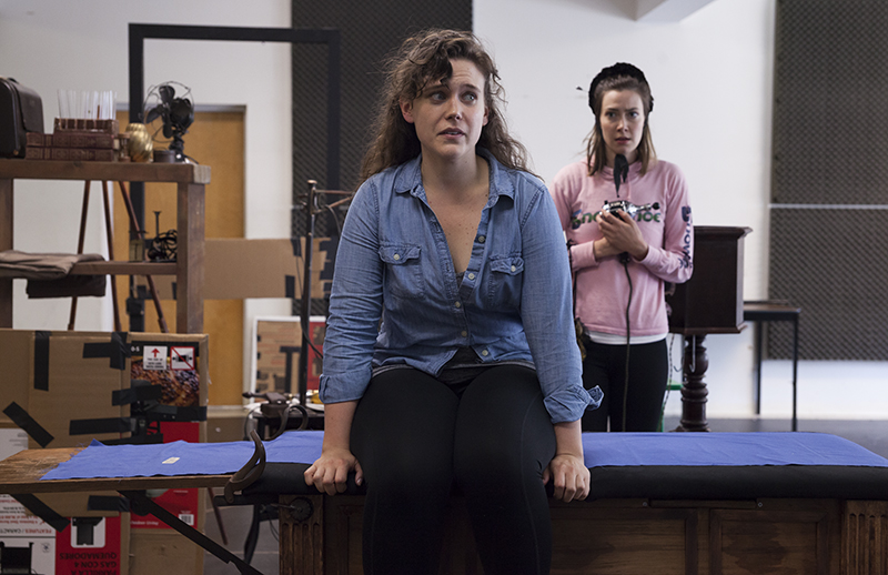 "Actresses Kathryn Metzger, left, and Allison Altman, right, as Catherine Givings and Sabrina Daldry, respectively, rehearse a scene from the Chautauqua Theater Company's upcoming production of Sarah Ruhl's ""In the Next Room (or the vibrator play),"" directed by Larissa Kokernot, in Brawdy Theater Studios on June 25, 2016.   In the show, the two actresses play women in the Victorian era who rediscover their own sexuality when Givings's husband introduces them to a mechanism that we know today as a vibrator. In this scene, the two women have had their first experience with the vibrator without their husbands, and Givings is horrified to have experienced her first ""paroxysm.""  Photo by Carolyn Brown."