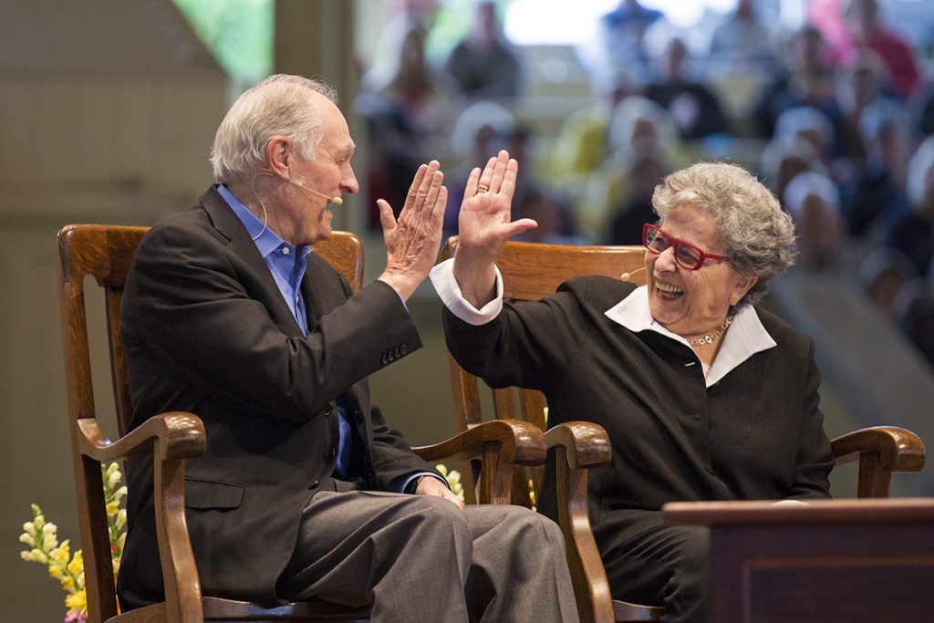 Actor Alan Alda and his wife, writer Arlene Alda, high-five after Tom Becker mentioned they have been married for 60 years during the morning lecture Friday, July 1, 2016 in the Amphitheater. Photos by Mike Clark.
