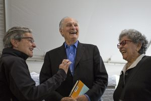 Chrissie Schelhas-Miller, left, speaks with actor Alan Alda, center, and his wife, writer Arlene Alda, after the morning lecture Friday, July 1, 2016 in the Artists Village.