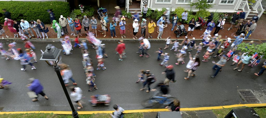 Friends and family line Pratt Ave. as children march in the annual Children's School Independence Day Parade Friday, July 1, 2016. Photo by Dave Munch.