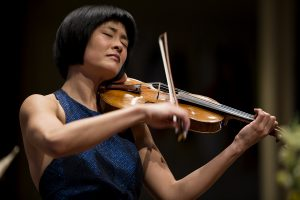 Jennifer Koh performs her solo Antonin Dvorak's Violin Concerto in A minor, B. 96/108, op. 53, with the Chautauqua Symphony Orchestra during the concert July 2, 2016 in the Amphitheater. Although Koh has performed along side Rossen Milanov , this was her first time performing with the CSO. She is known for her enthusiasm and passion as a performer. Photo by Eslah Attar