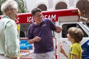Steven Osgood, center, the new artistic and general director of Chautauqua Opera Company speaks with his son Ronan Osgood, 8, and Bob Pickens during a welcome reception Sunday, June 3, 2016, outside Norton Hall. Free ice cream was provided at the reception which was a chance for the public to meet Osgood.
