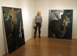 Kyle Staver stands near two of her large-scale works.