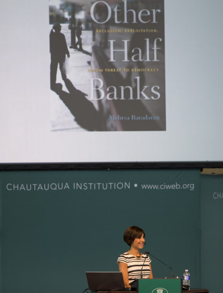 Mehrsa Baradaran, author of How the Other Half Banks: Exclusion, Exploitation, and the Threat to Democracy, delivers her lecture on banking inequality in America July 5, 2016 in the Amphitheater. In her book, Baradaran proposed a solution: postal banking, which will allow branches of the U.S. Postal Service to facilitate basic bank services such as check cashing, savings accounts and small loans. Photos by Eslah Attar
