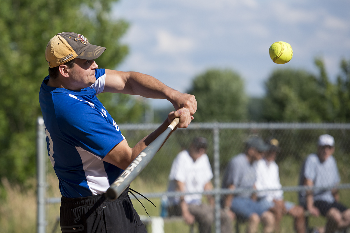 Sean Uber, a member of the Slugs, bats during a game against the Arthritics at Sharpe Field on July 1, 2016. This was the 300th win for the Slugs with a score of 21 to 9.