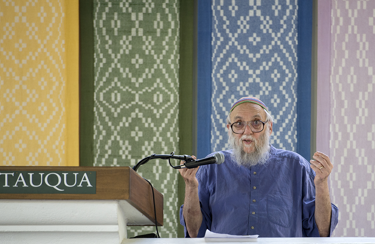 "Rabbi Arthur Waskow delivers his lecture, ""Whose Image Is on the Coin"" in the Hall of Philosophy on July 5, 2016. Waskow spoke about the influences religion and spirituality have on money and power. Photo by: Sarah Holm"