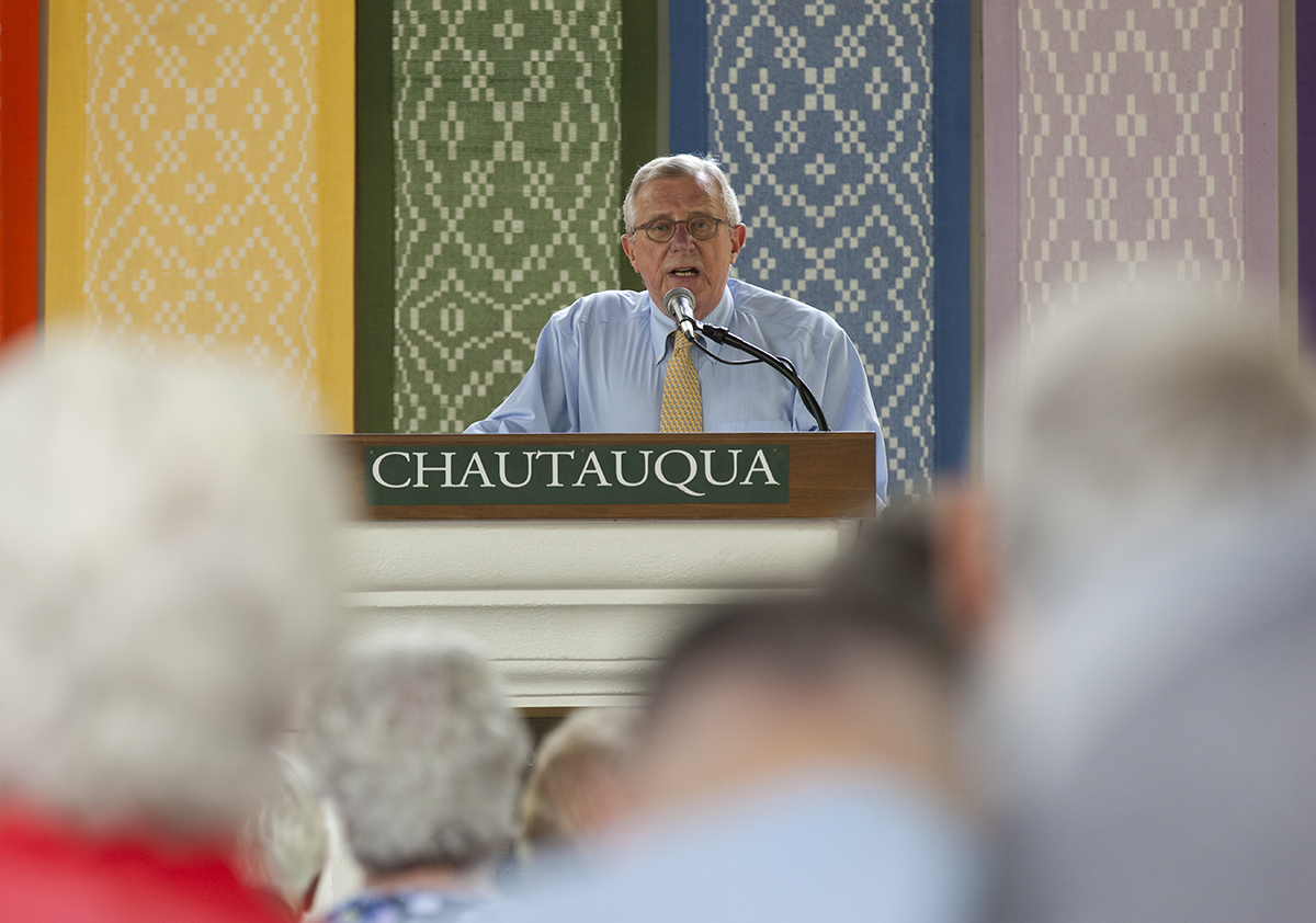 "John M. Buchanan, former editor and publisher of ""The Christian Century,"" delivers a lecture entitled ""Your Money or Your Life"" as part of the Week Two Interfaith Lecture Series at 2 PM on July 7, 2016, in the Hall of Philosophy. Buchanan's lecture discussed the ways that religious authorities throughout history have tried to rationalize and work around the Bible's exhortations to shun wealth and greed. Photo by Carolyn Brown."