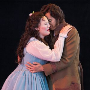"Caitlin Lynch and Dominic Armstrong perform as Violetta Valery and Alfredo Germont in the dress rehearsal for ""La Traviata"" on Wednesday, July 6, 2016 in the Amphitheater. The opera will be the evening performance on Saturday, July 9."