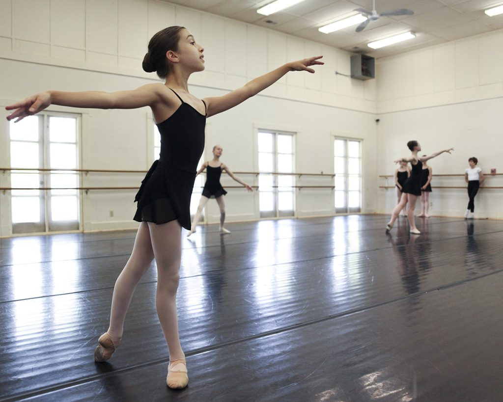 Renee Shubov, left, dances during a rehearsal with other other Workshop I ballet students at 2 PM on July 6, 2016, at the Carnahan-Jackson Dance Studios. The Workshop I students rehearsed a piece with their teacher Rebecca Janes in advance of their Workshop I studio show at 1 p.m. on Saturday, July 9, 2016, in the Verdy and McBride studios at the Carnahan-Jackson Dance Studio. Photo by Carolyn Brown.