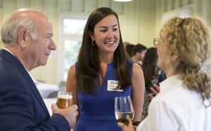 Mhoire Murphy, center, speaks with Vivienne Benesch and Tom Becker at the NOW Generation reception Sunday, July 3, 2016, at the Girls' Club. NOW Generation aims to attract millennials to Chautauqua.