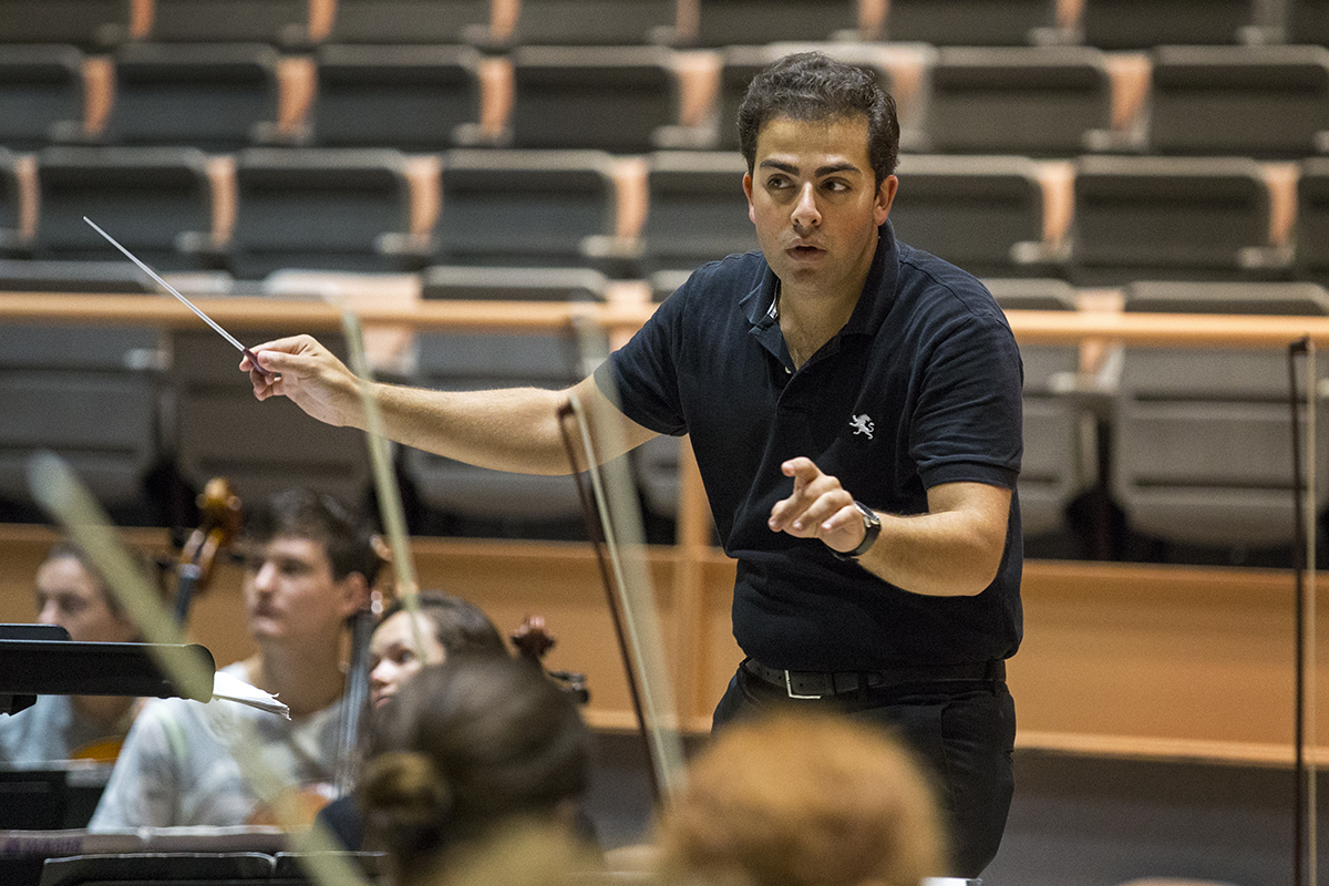 The Music School Festival Orchestra conducting fellow Louis lohraseb, conducts the MSFO during rehearsals Friday, July 8, 2016, in Elizabeth S. Lenna Hall.