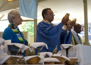 Robert Michael Franklin Jr. breaks the bread to initiate communion during morning worship in the Amphitheater on July 10, 2016. Photo by Sarah Holm