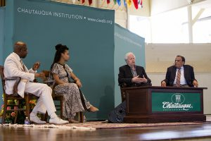 Adam Young, Bill Moyers, Ouleye Ndoye and her husband Rev. Raphael G. Warnock discuss race relations during the morning lecture Monday July 11, 2016 in the Amphitheater. Photo by Eslah Attar