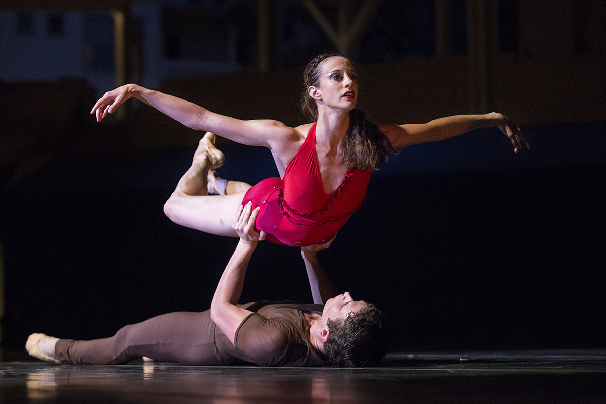 "Josh Hall lifts Alessandra Ball James in the movement ""Lascia la Spina, Cogli la Rosa"" during the Charlotte Ballet's performance with the Chautauqua Symphony Orchestra on Tuesday, July 12, 2016, in the Amphitheater."