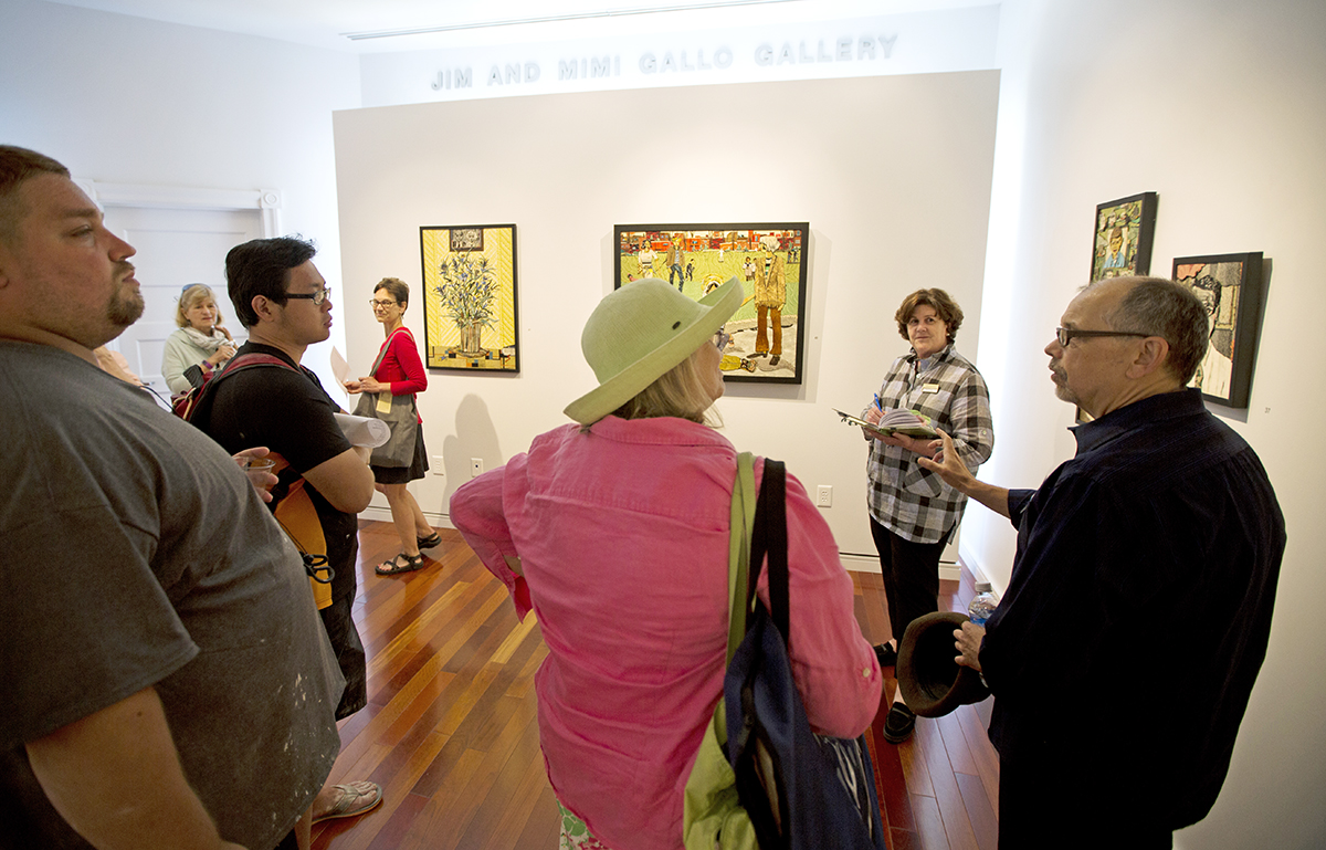 "Artist, Bill Miller, (right) explains the process of his art work to gallery attendees during the opening reception for ""The Art of Making Collages"" in Fowler-Kellogg Art Center Wednesday June 29, 2016. Photo by Eslah Attar"