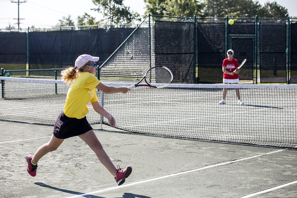 Katherine Shultze, 13, runs for the ball during a round of the Team Tennis Tournament. Chautauquans participated in this summers Team Tennis Tournament July 24, 2015.