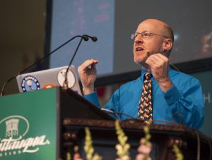 "Phil Plait, creator of Slate's ""Bad Astronomy"" blog, delivers a lecture entitled ""Death from the Skies!"" at 10:45 AM on July 18, 2016, in the Amphitheater. Plait discussed asteroid impacts and the accuracy of science fiction movies like ""Armageddon."" Photo by Carolyn Brown."
