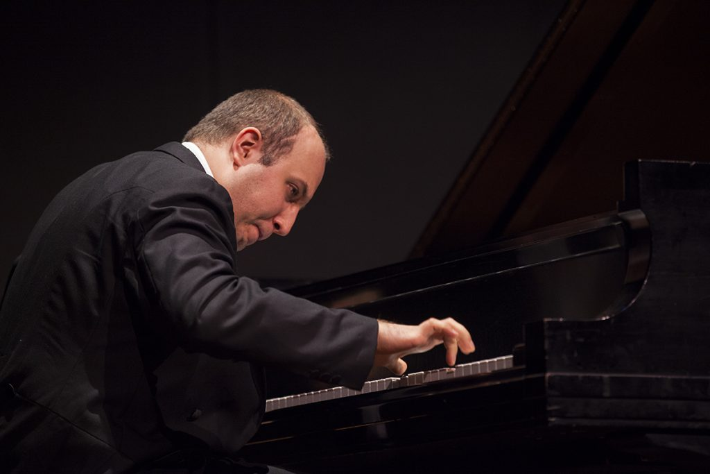 "Pianist Alexander Gavrylyuk performs  Prokofiev's ""Piano Sonata No. 3 in A minor, op. 28"" in a recital at 8:15 PM on July 20, 2016, in the Amphitheater. Although this was a solo recital, Gavrylyuk will also perform with the Chautauqua Symphony Orchestra at 8:15 PM on July 23, 2016, in the Amphitheater. Photo by Carolyn Brown."