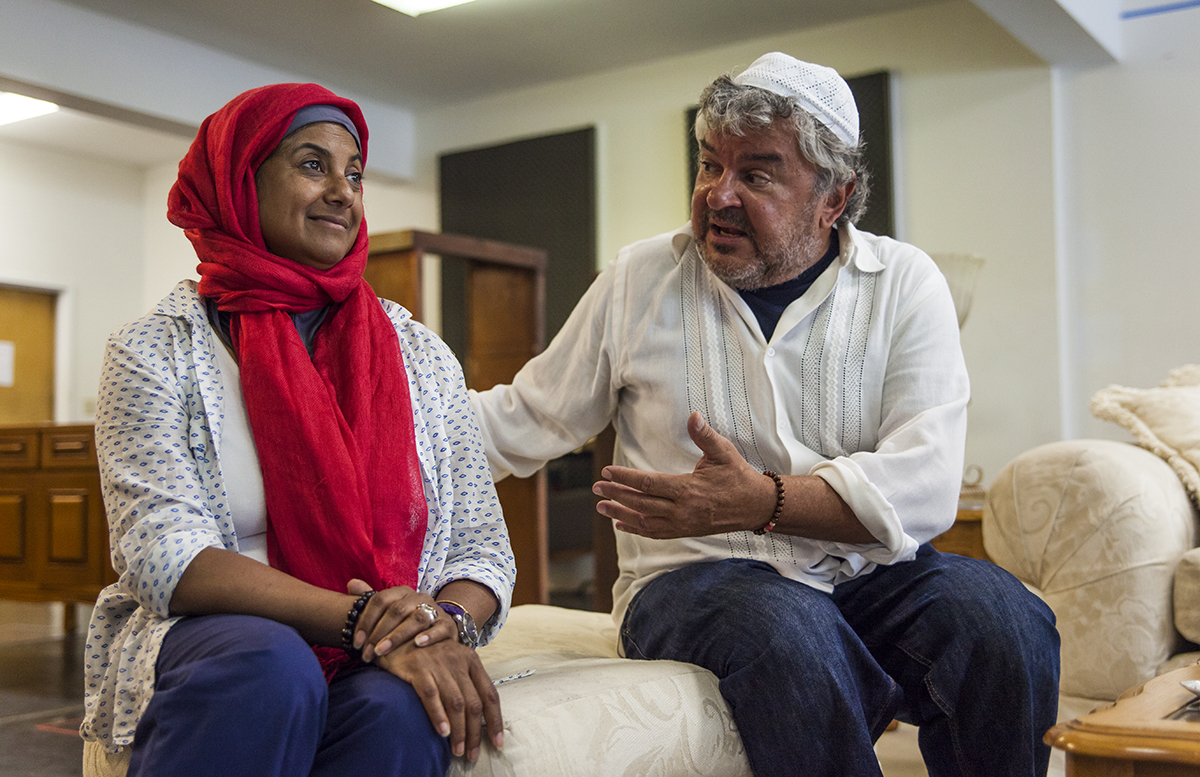 "Rita Wolf, left, and Edward Furs, right, as the characters Carmen and Peter, respectively, rehearse a scene from the Chautauqua Theater Company's upcoming production of Zayd Dohm's ""The Profane."" The show focuses on the the conflict that arises when a professor's daughter falls in love with the son of Muslim fundamentalists. Photo by Carolyn Brown."