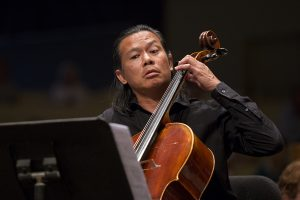 "Felix Fan plays a cello solo in the world premiere of ""Almost Truths and Open Deceptions"" by Annie Gosfield during the Chautauqua Symphony Orchestra concert Thursday, July 21, 2016, at the Amphitheater. Photo by: Mike Clark"