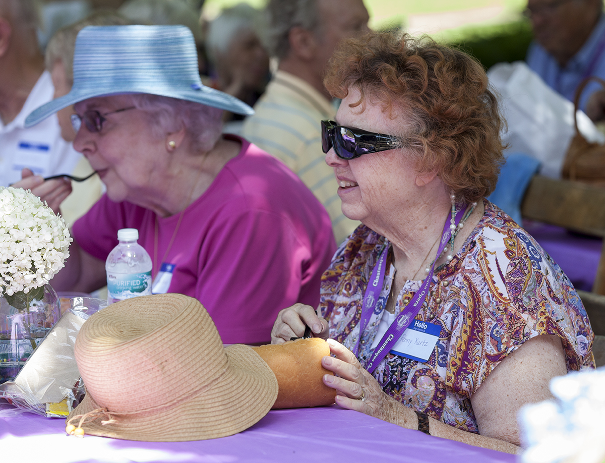 Loretta Bower, left, and Penny Kurtz, right, enjoy the food at the Opera Guild Picnic at noon on July 21, 2016, on the lawn outside Norton Hall. Steven Osgood, Artistic and General Director of Chautauqua Opera Company, addressed the Opera Guild during the picnic, thanking them for their support and discussing the Chautauqua Opera Company's 2017 season. Photos by Carolyn Brown.