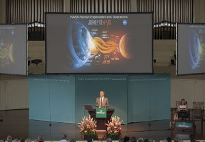 "NASA Chief Technologist David W. Miller presents the second half of a lecture entitled ""Looking Outward, Inward and Homeward"" at 10:45 AM on July 22, 2016, in the Amphitheater. NASA Chief Scientist Ellen Stofan presented the first half. Photo by Carolyn Brown."