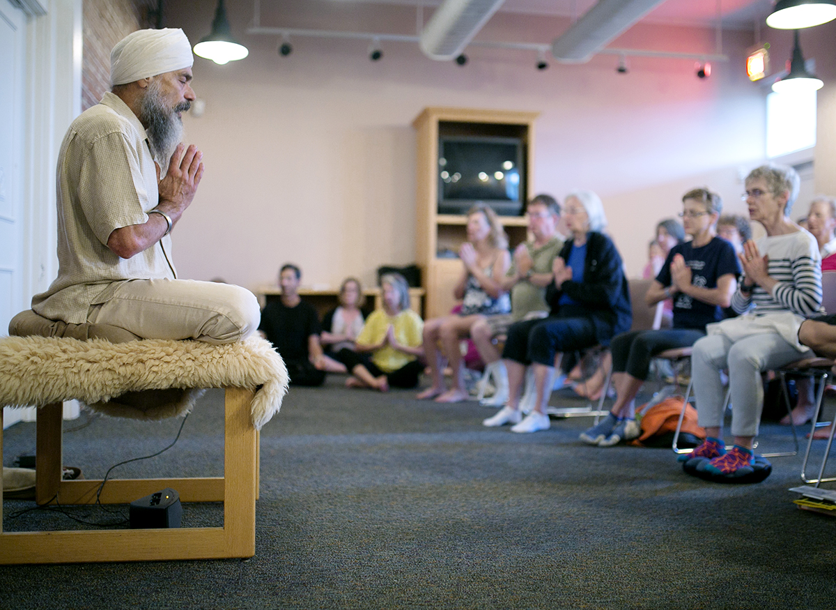 Director of the Mystic Heart Meditation program and Week Six teacher-in-residence with the Mystic Heart Community, Subagh Singh Khalsa, leads the first meditation session of the week Monday at the Main Gate Welcome Center.