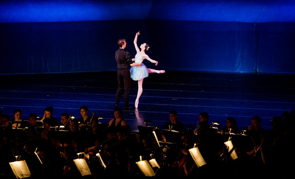 "Michael Menghini and Rheya Shano perform a segment titled ""Embraceable you"" as part of a larger piece called ""Who Cares?"" during the Chautauqua Festival Dancers with the Music School Festival Orchestra July 25, 2016 in the Amphitheater. The students previously performed the piece in the Chautauqua Dance Student Gala last week. Photo by Eslah Attar."