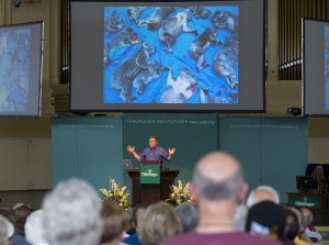 Photographer and National Geographic contributor Joel Sartre delivers the morning lecture Monday, July 25, 2016, in the Amphitheater. Photo by: Mike Clark