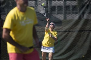Judy Williams serves while playing with her teammate Karan Chopra during the team tennis tournament Saturday, July 23, 2016, at the Chautauqua Tennis Center. Photo by: Mike Clark