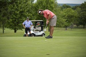 Ben McCauley, putts as his father Jack McCauley watches during the Men's Member Guest Golf Tournament on Sunday, July 24, 2016, at the Chautauqua Golf Club. Photo by: Mike Clark