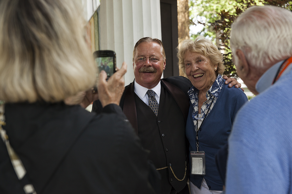 Dotsy Liles (left) takes a photo of Theodore Roosevelt impersonator Joe Wiegand posing poses for a photo with Chautauquan Phoebe Ford (center) after Wiegand's 2 PM lecture at the Hall of Philosophy on June 28, 2016. Wiegand's lecture, the first of the season in the Heritage Lecture Series, described Roosevelt's involvement with the creation of America's national parks, as well as Roosevelt's various experiences in politics throughout his life. Photo by Carolyn Brown.