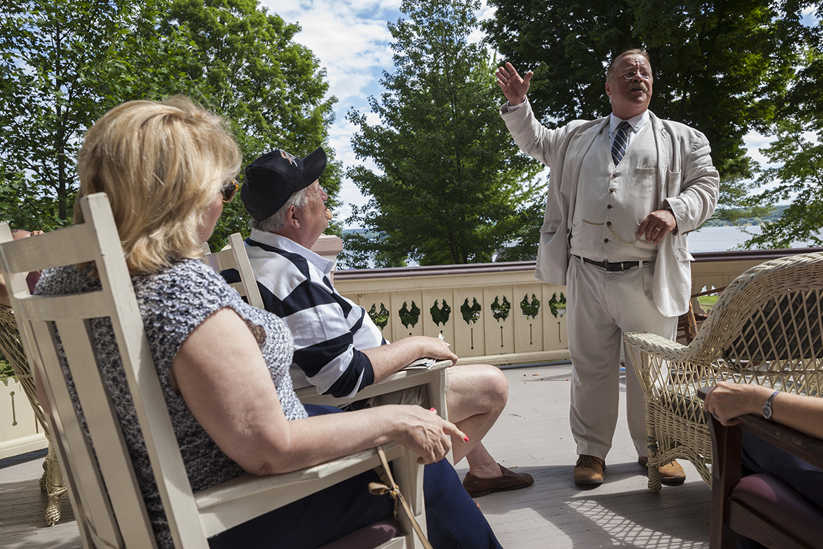 Wiegand addresses Chautauquans as Theodore Roosevelt at 11 AM on June 28, 2016, on the Atheneum porch. Wiegand's talk discussed various topics relating to Theodore Roosevelt's life, including Roosevelt's political views and his involvement in the creation and maintenance of America's national parks. Photo by Carolyn Brown.