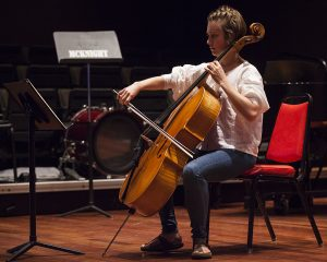 "Cellist Grace Hartman plays ""Cello Suite #1 in G Major, Prelude and Courante"" by Bach at Zeitgeist, an event presented by the Chautauqua Inter-Arts Collective, at 7 PM on July 17, 2016, at McKnight Hall. Julian Loida created the event to encourage collaboration between the various schools of art and the performing arts at Chautauqua. Photo by Carolyn Brown."