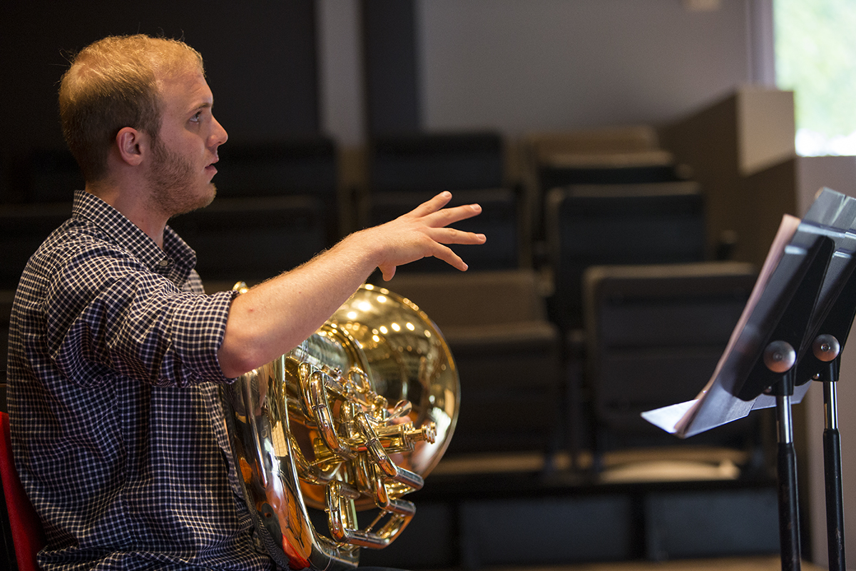 "Evan Zegiel rehearses his piece titled ""Under Mountains of Ocean"" by composer Nelson Gast July 30, 2016 in McKnight Hall. Zegiel will perform the world premiere of his piece in an open recital at 2 p.m. the first of August in McKnight Hall. Photo by Eslah Attar"