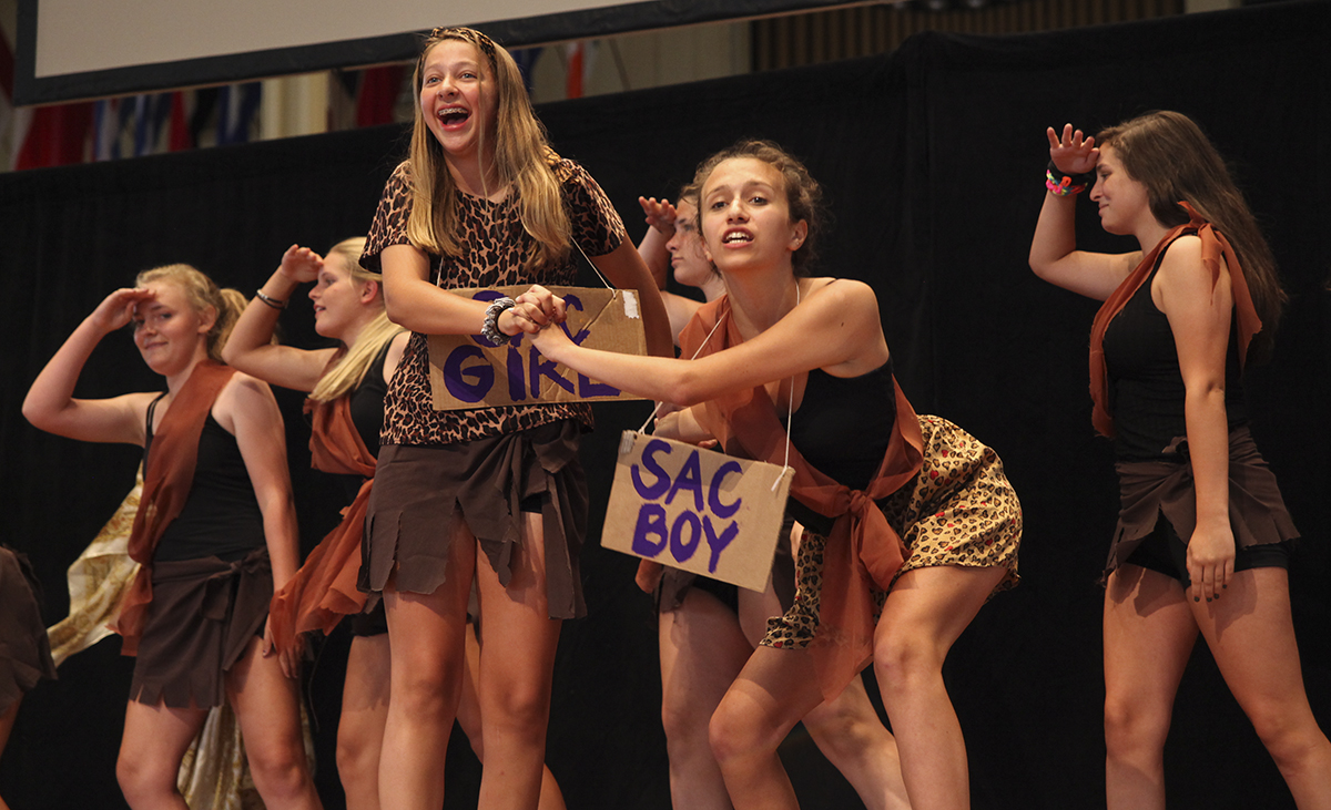 "Campers in SAC Girls perform their group's skit, ""The Evolution of SAC Girls,"" during Air Band, an annual Boys' and Girls' Club tradition, at 4:30 PM on July 28, 2016, at the Amphitheater. SAC Girls would later tie with SAC Boys for the Best Overall award. Photo by Carolyn Brown."
