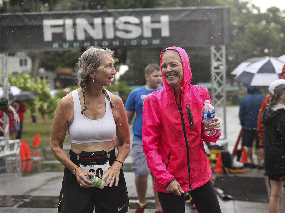 Janet Posner, left, chats with Betsy Goodell, right, after the Old First Night race at 9 A.M. on Saturday, July 30, 2016, outside the Sports Club. 15-year-old Tyler Clark was the overall winner of the race. Photo by Carolyn Brown.