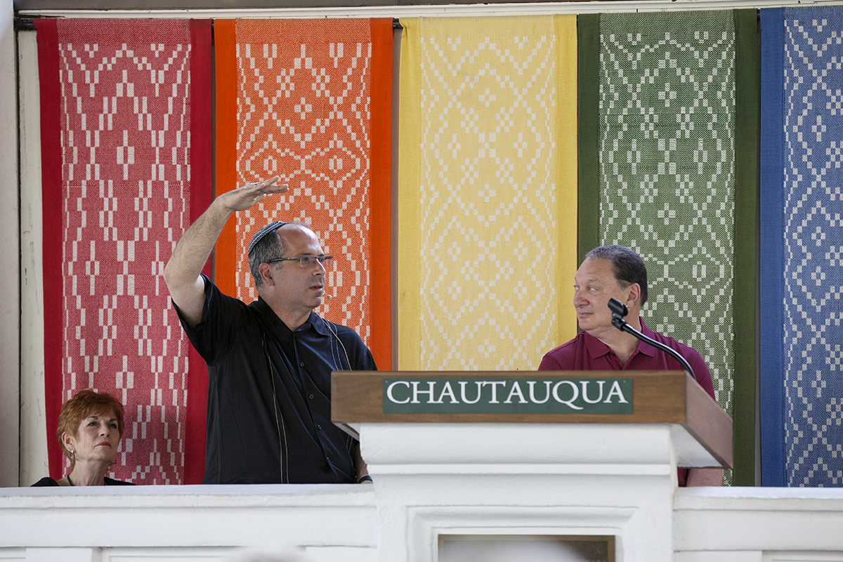 Rabbi Robert Nosanchuck, center, and Ronn Richard, right, discuss faith issues and race relations at 2 P.M. on August 2, 2016, at the Hall of Philosophy. The speakers, including  Rev. Steven Rowan, not pictured, work in Cleveland and particularly focused on issues relating to the city in particular.  Photo by Carolyn Brown.