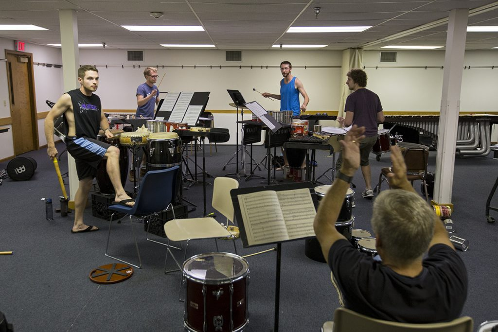 Cameron Leach, left to right, Julian Loida, Brian Cannady and Matt Flanders practice  a piece by composer John Cage on Tuesday, Aug. 2, 2016, in Bellinger Hall. Cage typically uses non-traditional instrumentation in his pieces such as tin cans.